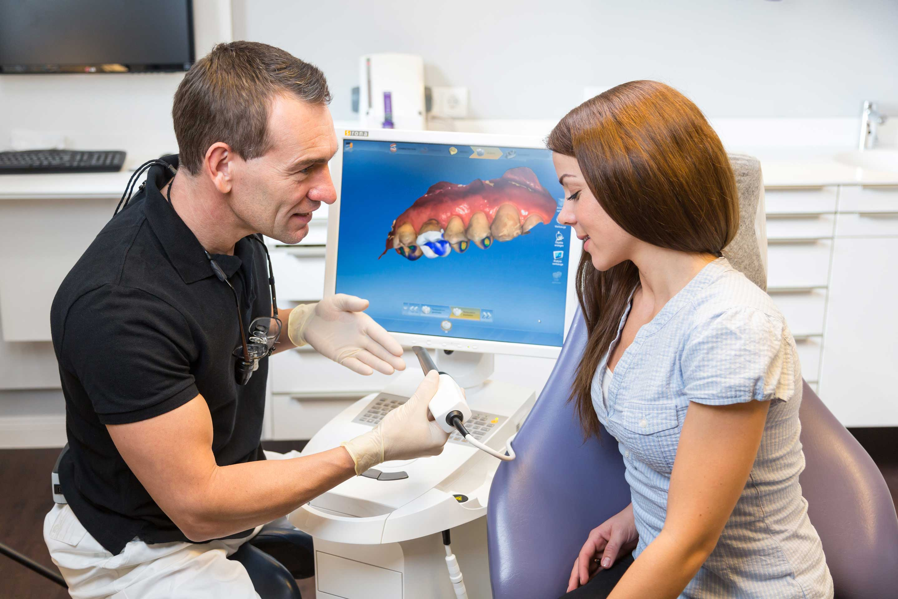 dentist showing patient cerec